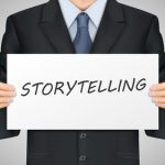 43687227 - close-up look at businessman holding storytelling word poster